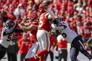 Houston Texans inside linebacker Benardrick McKinney (55) pressures Kansas City Chiefs quarterback Patrick Mahomes (15) during the second quarter of an NFL game at Arrowhead Stadium Sunday, Oct. 13, 2019, in Kansas City, Mo.