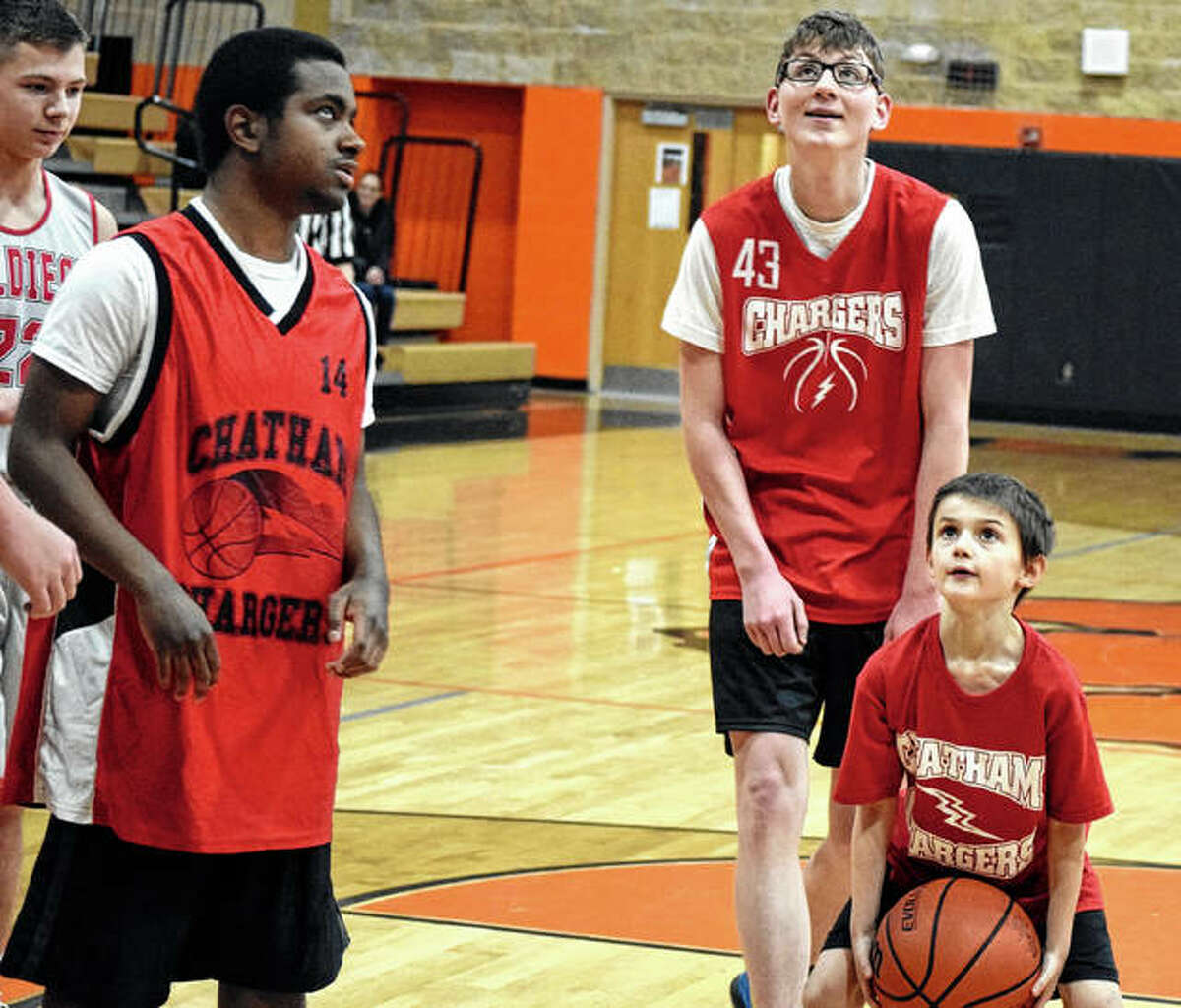 Members of the Chatham Chargers play against Beardstown Christian Academy Saturday during the Beardstown Area Special Athletes 88 Hoops Classic at Beardstown High School. The organization provides opportunities for students to participate in Special Olympics activities.