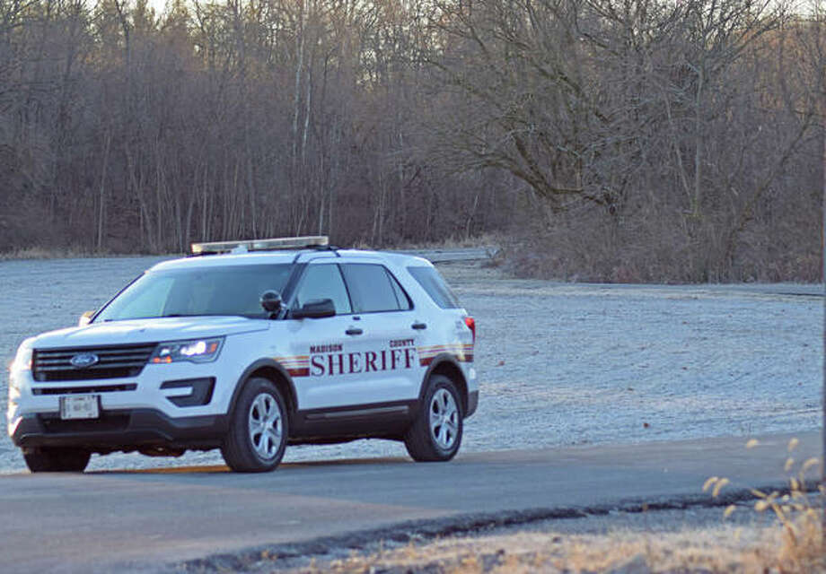 A Madison County Sheriff squad car was stationed at the end of Mooney Creek Lane early Sunday morning, keeping traffic to a minimum. Photo: Tyler Pletsch | The Intelligencer