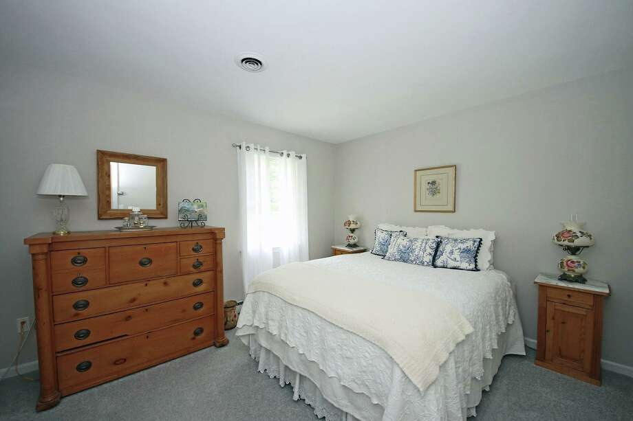 There are three bedrooms in this house, including the master suite, and a possible fourth on the lower level.