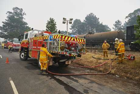 WINGELLO, AUSTRALIA - JANUARY 05: Fire crews refill their trucks from a rail water tanker on January 5, 2020 in Wingello, Australia. One person has died overnight in Batlow and four firefighters were injured. A state of emergency is in place across NSW as firefighters battle 150 fires, 64 of which are uncontained. Prime Minister Scott Morrison on Saturday announced that army reservists were being called up to help with firefighting efforts across Australia, along with extra ships and helicopters. 14 people have now died in the fires in NSW, Victoria and South Australia since New Year's Eve. (Photo by Brett Hemmings/Getty Images)