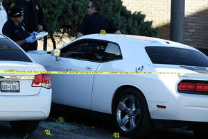 San Antonio Police investigate the scene of a double shooting at the Pecan Valley Golf Club Apartments, Sunday, Jan. 5, 2020. According to SAPD spokesperson Sgt. Michelle Ramos, two teenagers, a girl and a boy, were in a white Dodge Charger when they were shot in the parking lot of the complex. The two were taken to a local hospital, one with a wound to his leg and the girl with wounds on her back.