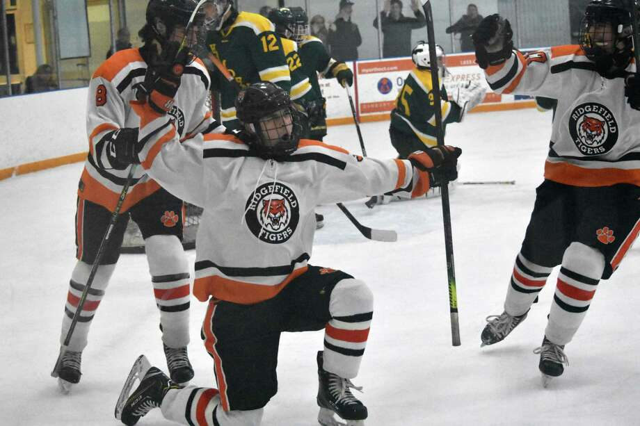 Ridgefield's Michael Conciatore celebrates his goal in the hockey game between Ridgefield and Hamden at the Winter Garden, Ridgefield on Saturday, Jan. 4, 2019. (Pete Paguaga, Hearst Connecticut Media)
