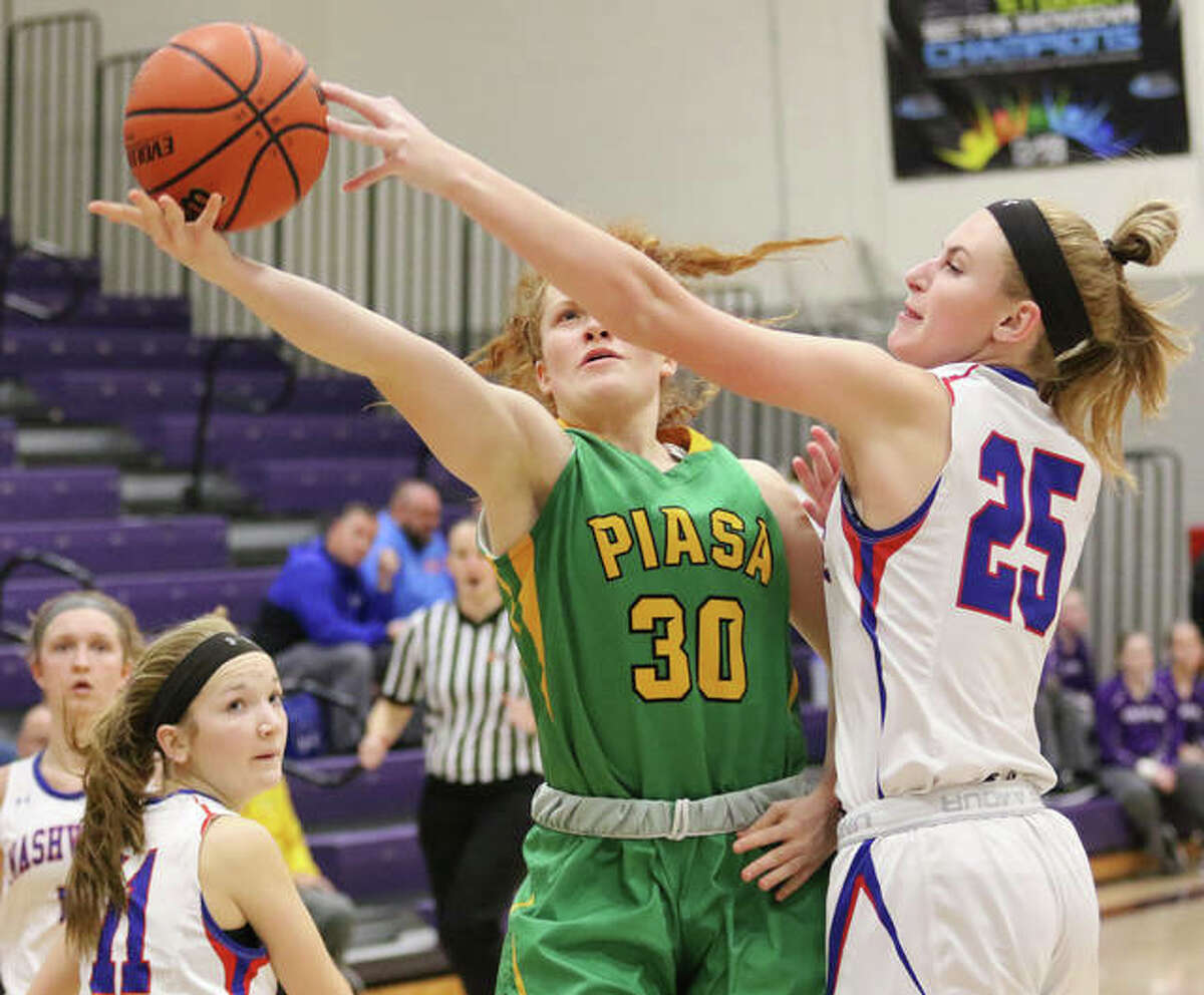 Southwestern's Rylee Smith (30) has her shot blocked by Nashville's 6-1 Rylee Luechtefeld during the second half Saturday night at Breese Central's PAWS Shootout in Breese.