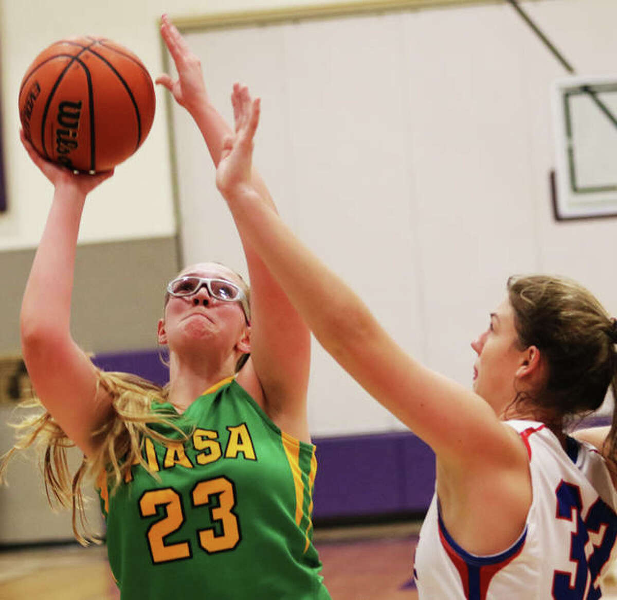 Southwestern's Annie Gallaher (right) shoots over Nashville's Alyssa Cole on Saturday night at the Breese Central Shootout in Breese.