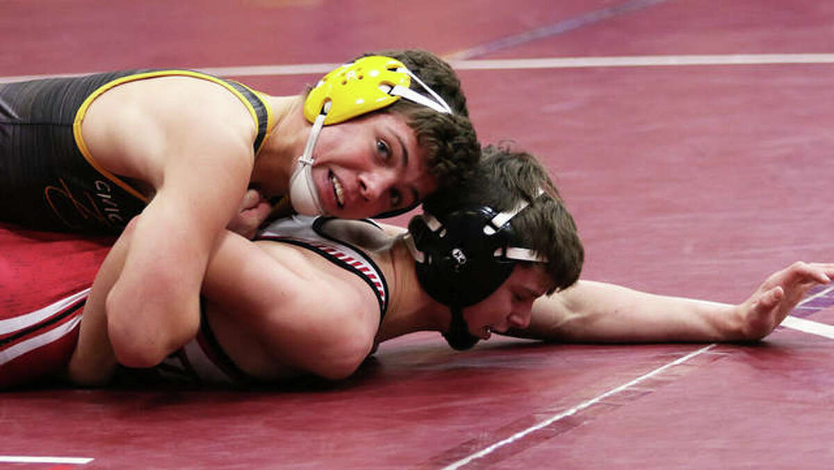 CM's Caleb Tyus (top), shown in control against Vandalia's Eric McKinney in a 132-pound bout at the CM Tournament on Dec. 7 in Bethalto, went 9-0 over the weekend at the Diamond State Duals in Springdale, Arkansas, to improve his record to 22-0.