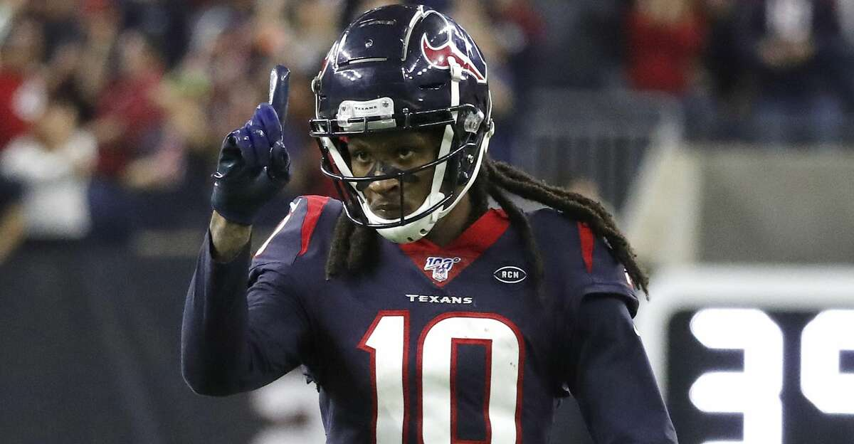 Houston Texans wide receiver DeAndre Hopkins (10) reacts after catching a pass from quarterback Deshaun Watson (4) against Buffalo Bills cornerback Tre'Davious White (27) during the fourth quarter of an AFC NFL wild card playoff game at NRG Stadium, Saturday, Jan. 4, 2020, in Houston.
