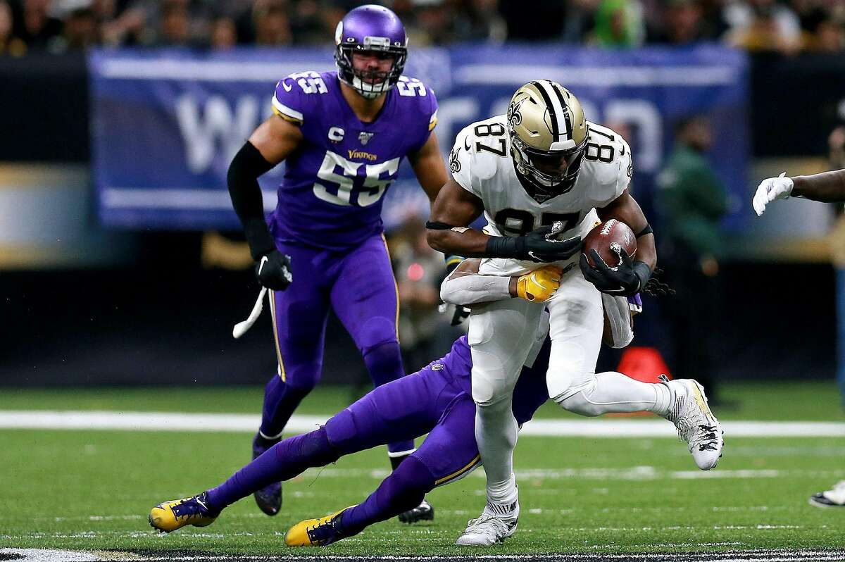 NEW ORLEANS, LOUISIANA - JANUARY 05: Jared Cook #87 of the New Orleans Saints makes a catch before being tackled by Anthony Harris #41 of the Minnesota Vikings in the NFC Wild Card Playoff game at Mercedes Benz Superdome on January 05, 2020 in New Orleans, Louisiana. (Photo by Sean Gardner/Getty Images)