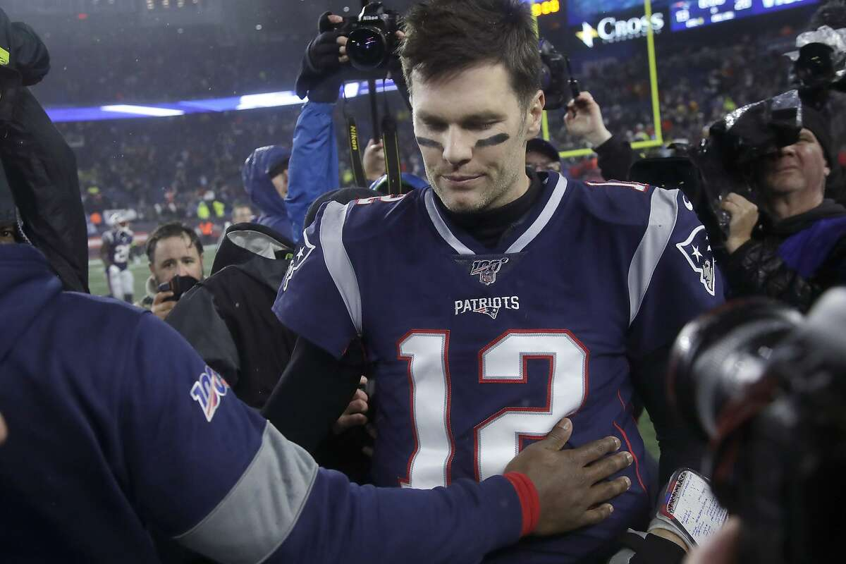New England Patriots quarterback Tom Brady leaves the field after losing to the Tennessee Titans in an NFL wild-card playoff football game, Saturday, Jan. 4, 2020, in Foxborough, Mass.