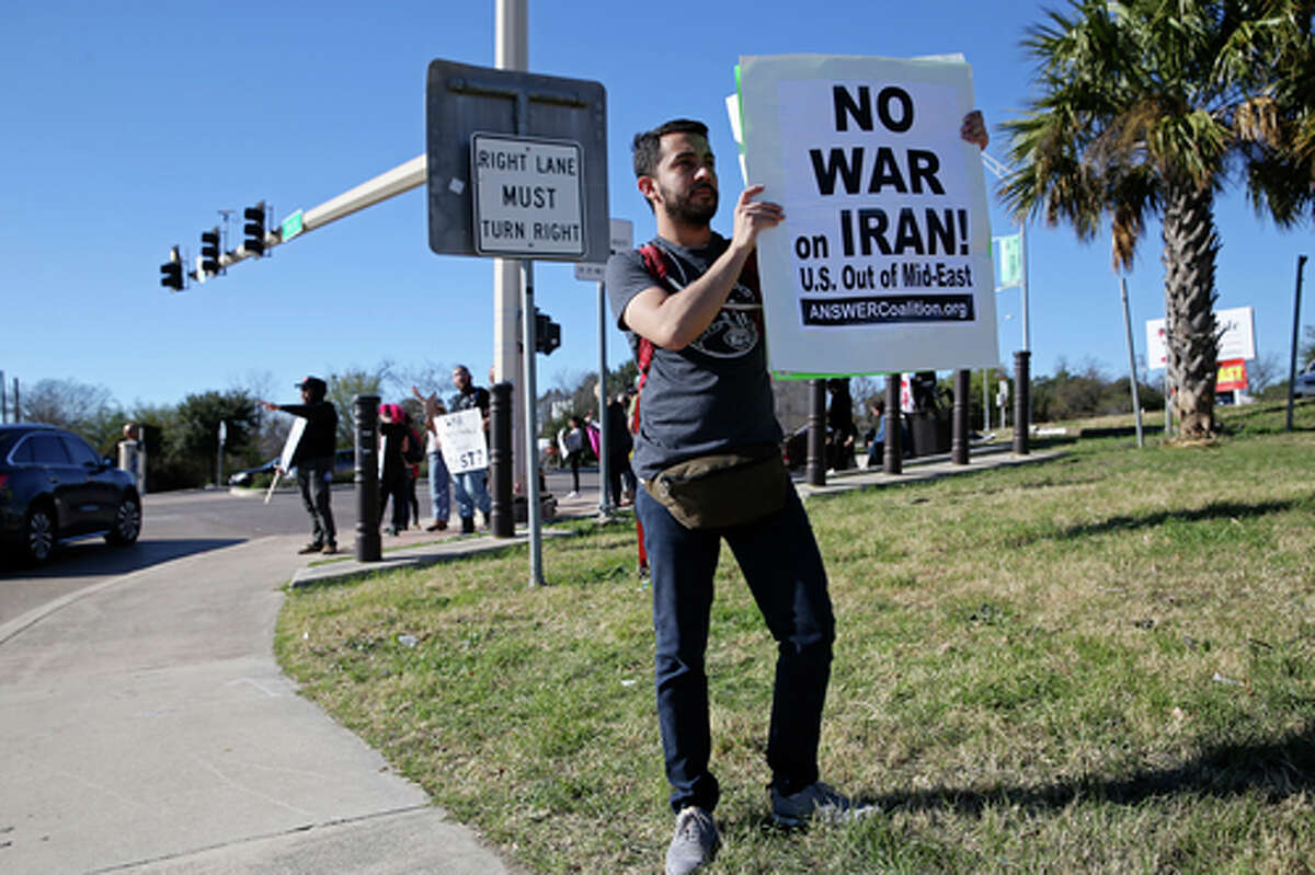 Jon Twining joins with other anti-war protestors gathered at the corner of North Walters Street and IH-35 to protest the escalation in Iraq, Sunday, Jan. 5, 2020. Several organizations, including the Brown Berets, The Party for Socialism and Liberation, and veterans groups, joined in the protest that including a march to the entrance of Joint Base San Antonio-Fort Sam Houston and back to the corner.