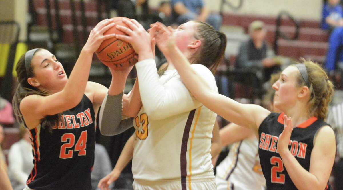 Sheehan's Caitlyn Hunt, center, seen against Sheehan last season, scored a game-high 17 points in the final of the Fred Kelly Memorial Holiday Tournament against Farmington last week.
