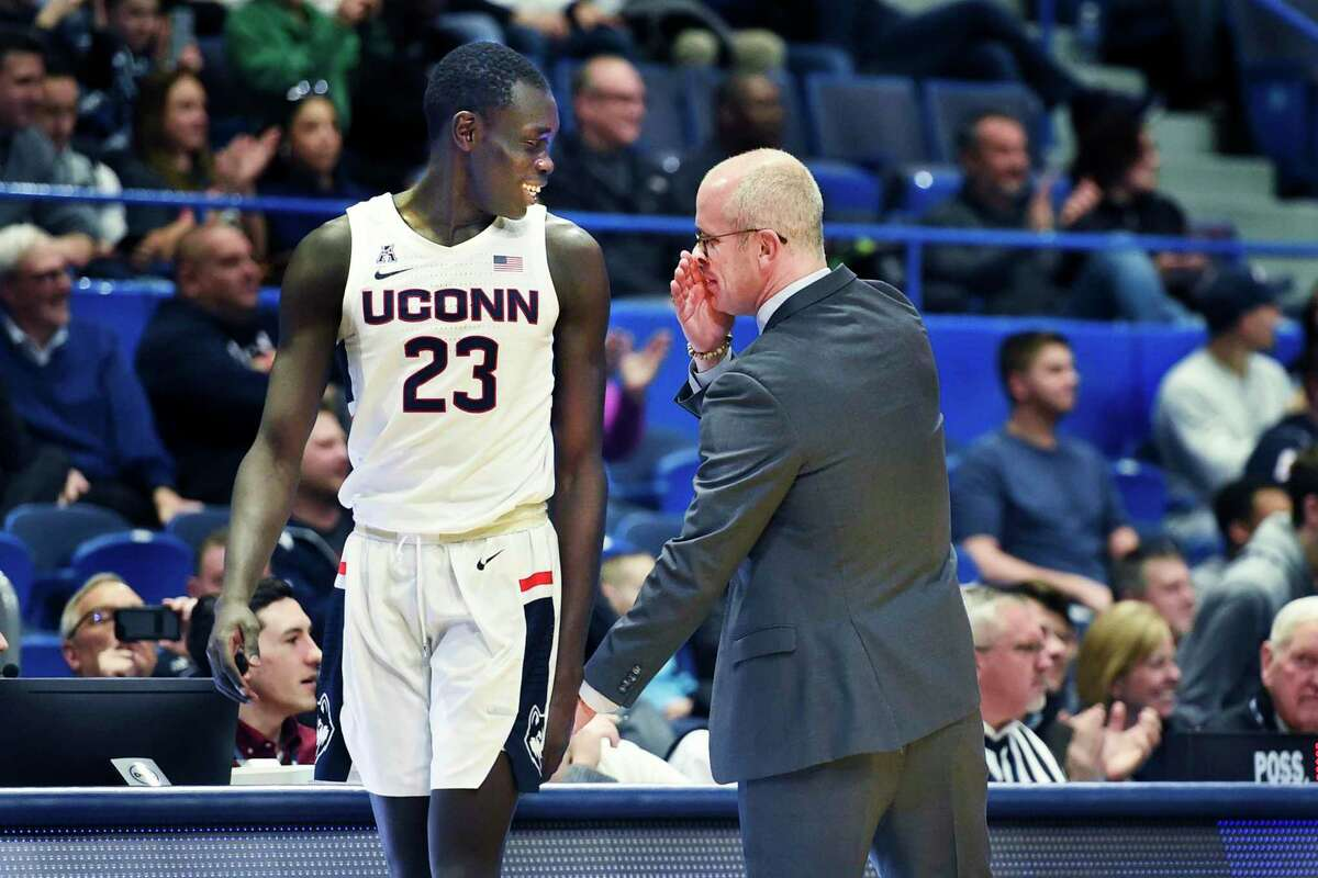 UConn's Akok Akok (23) gets a message from head coach Dan Hurley during a December game in Hartford. The health of Akok, and all the Huskies, will be key to the team's success this season.