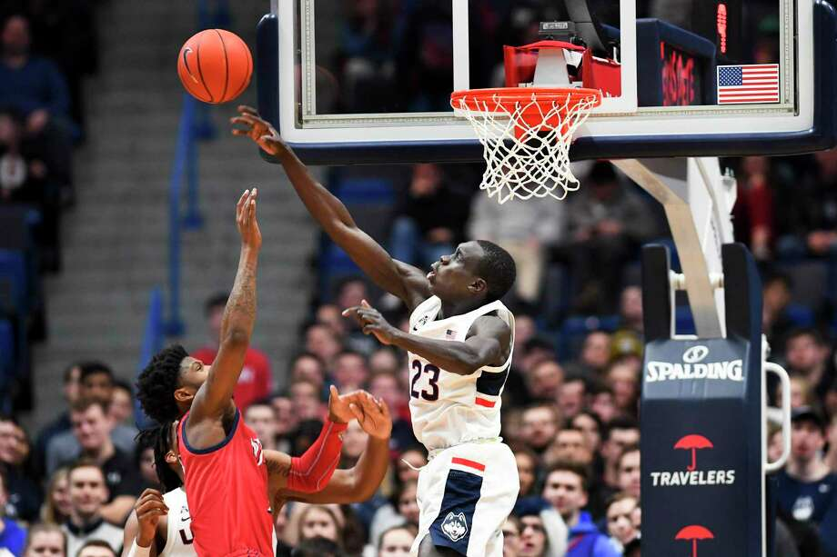 Connecticut's Akok Akok (23) blocks the shot of New Jersey Institute of Technology's San Antonio Brinson (2) in the second half of an NCAA college basketball game Sunday, Dec. 29, 2019, in Hartford, Conn. Akok had 5 blocks in the game. (AP Photo/Stephen Dunn) Photo: Stephen Dunn / Associated Press / Copyright 2019 The Associated Press. All rights reserved