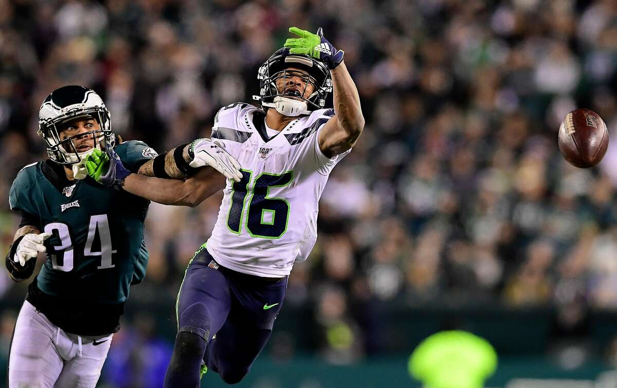 PHILADELPHIA, PENNSYLVANIA - JANUARY 05: Tyler Lockett #16 of the Seattle Seahawks is unable to complete a catch over Cre'von LeBlanc #34 of the Philadelphia Eagles during the NFC Wild Card Playoff game at Lincoln Financial Field on January 05, 2020 in Philadelphia, Pennsylvania. (Photo by Steven Ryan/Getty Images)