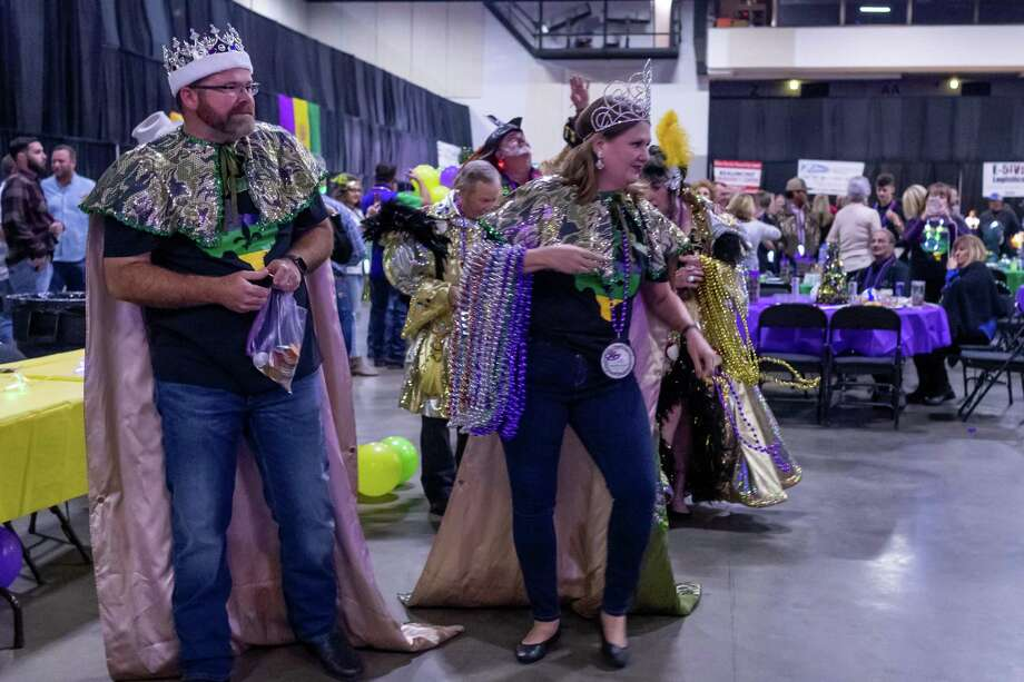 Krewes toss beads into the crowd as Mardi Gras season kicks off with the annual Beans N Jeans party at the Beaumont Civic Center with Mardi Gras moving to Beaumont this year. Photo made on Saturday, January 4, 2020. Fran Ruchalski/The Enterprise Photo: Fran Ruchalski/The Enterprise / 2019 The Beaumont Enterprise