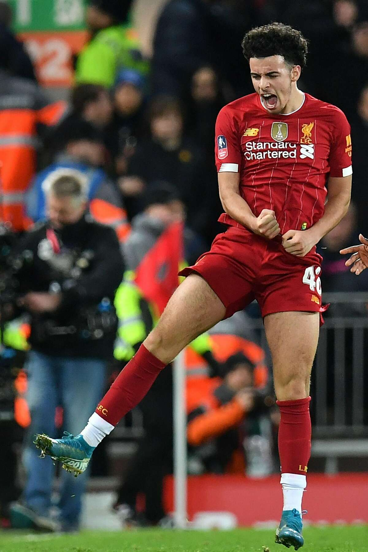 Liverpool's English midfielder Curtis Jones celebrates after scoring the opening goal of the English FA Cup third round football match between Liverpool and Everton at Anfield in Liverpool, north west England on January 5, 2020. (Photo by Paul ELLIS / AFP) / RESTRICTED TO EDITORIAL USE. No use with unauthorized audio, video, data, fixture lists, club/league logos or 'live' services. Online in-match use limited to 120 images. An additional 40 images may be used in extra time. No video emulation. Social media in-match use limited to 120 images. An additional 40 images may be used in extra time. No use in betting publications, games or single club/league/player publications. / (Photo by PAUL ELLIS/AFP via Getty Images)