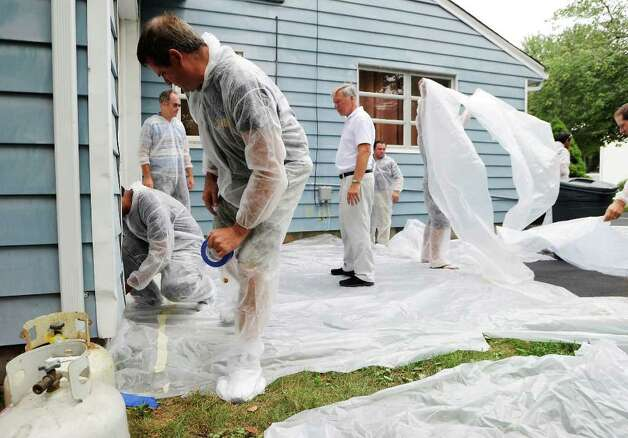 lead paint rules require plastic to catch all the lead paint removed from older houses