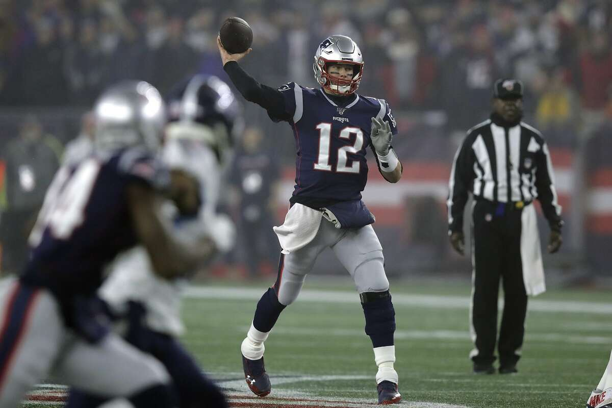 New England Patriots quarterback Tom Brady passes against the Tennessee Titans in the first half of an NFL wild-card playoff football game, Saturday, Jan. 4, 2020, in Foxborough, Mass.