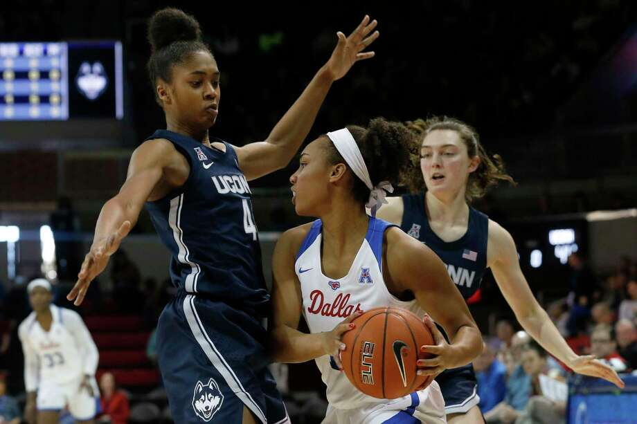 Connecticut guards Aubrey Griffin (44) and Molly Bent, right, defend against SMU guard Reagan Bradley (13) during the first half of an NCAA women's basketball game in Dallas on Sunday, Jan. 5, 2020. Photo: Michael Ainsworth / Associated Press / Copyright 2020 The Associated Press. All rights reserved.