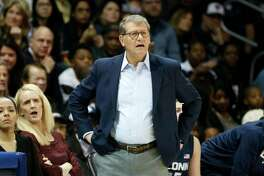 """Connecticut head coach Geno Auriemma watches the first half of an NCAA women's basketball game against SMU in Dallas on January 5, 2020. Auriemma is taking some heat for calling his players """"dummies"""" following their first loss of the season to Baylor last week."""