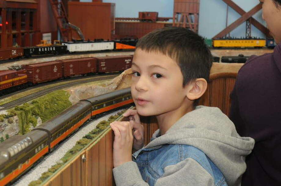 """Lucas Ondra, 7, of O'Fallon said, """"This layout is pretty good,"""" as he watched model trains operate on the train club's layout Saturday. Photo: David Blanchette