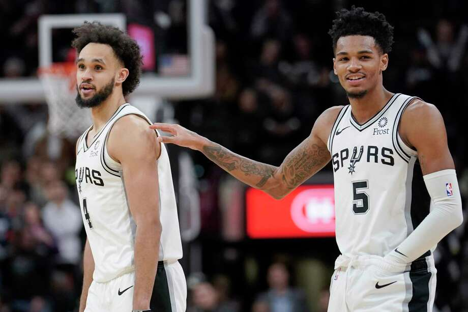 With Dejounte Murray, right, returning from missing a game, guard Derrick White, left, will return to coming off the bench for the Spurs in tonight's home game with Milwaukee. Photo: Darren Abate / Associated Press / Copyright 2019 The Associated Press. All rights reserved.