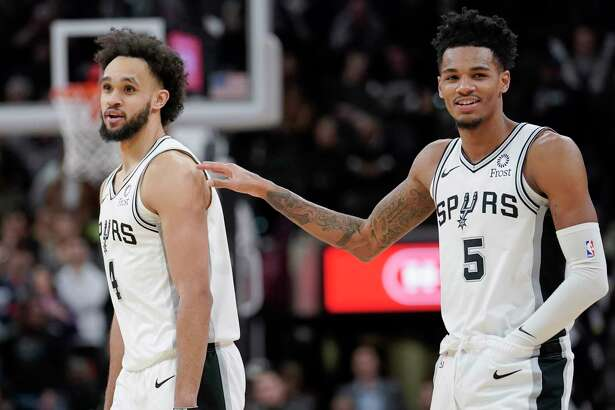 With Dejounte Murray, right, returning from missing a game, guard Derrick White, left, will return to coming off the bench for the Spurs in tonight's home game with Milwaukee.