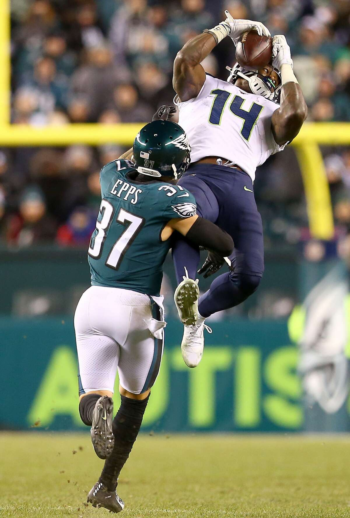 PHILADELPHIA, PENNSYLVANIA - JANUARY 05: D.K. Metcalf #14 of the Seattle Seahawks catches a pass over Marcus Epps #37 of the Philadelphia Eagles in the fourth quarter of the NFC Wild Card Playoff game at Lincoln Financial Field on January 05, 2020 in Philadelphia, Pennsylvania. (Photo by Mitchell Leff/Getty Images)