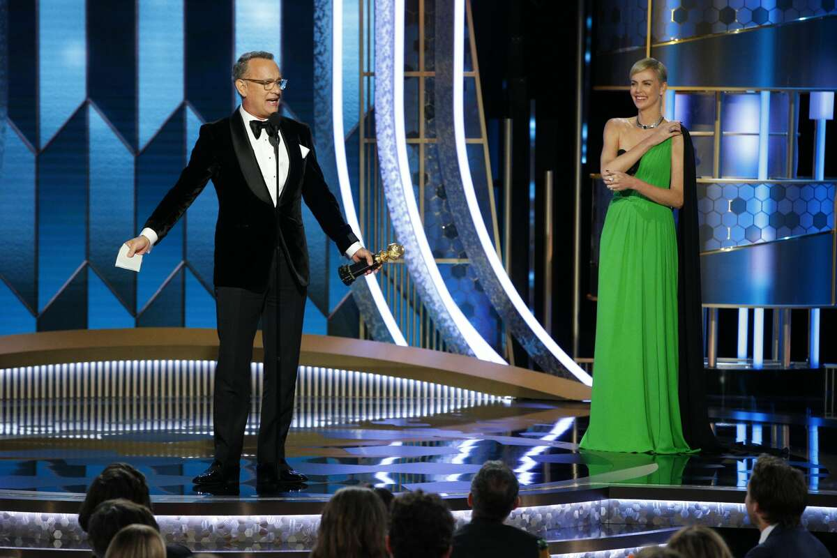 Tom Hanks accepts the CECIL B. DEMILLE AWARD, presented by Charlize Theron, onstage during the 77th Annual Golden Globe Awards at The Beverly Hilton Hotel on January 5, 2020 in Beverly Hills, California. (Photo by Paul Drinkwater/NBCUniversal Media, LLC via Getty Images)