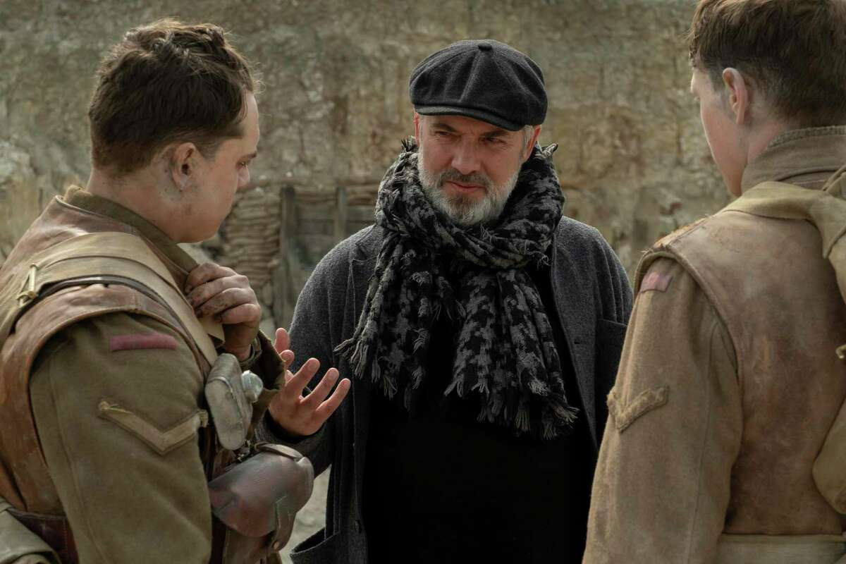 Dean-Charles Chapman, director Sam Mendes and George MacKay on the set of '1917'