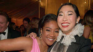 Tiffany Haddish and Awkwafina attend The 2020 InStyle And Warner Bros. 77th Annual Golden Globe Awards Post-Party at The Beverly Hilton Hotel on January 05, 2020 in Beverly Hills, California. (Photo by Lester Cohen/Getty Images for InStyle)