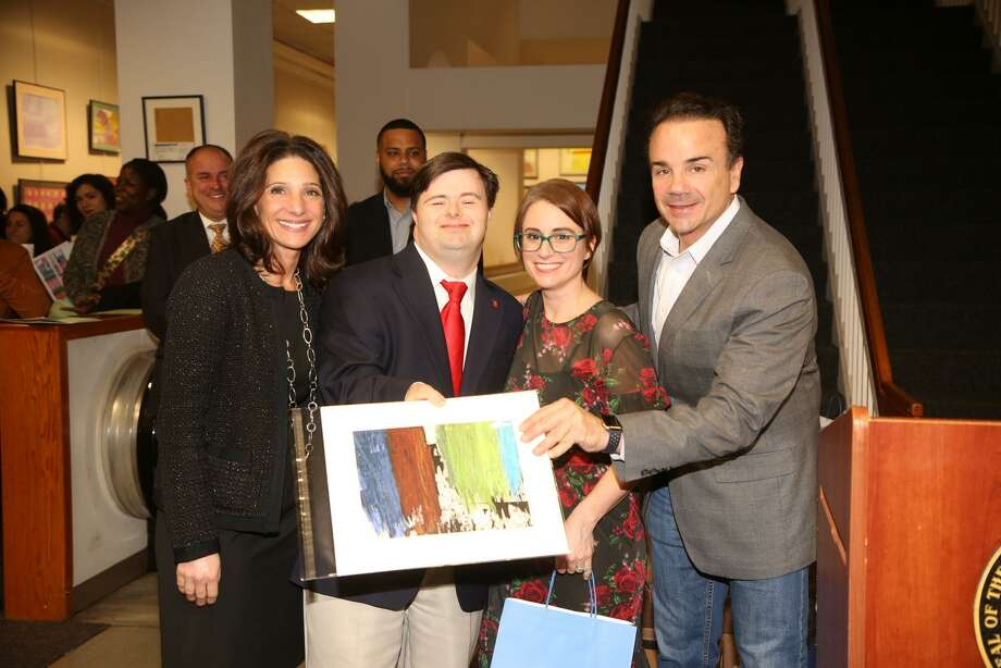 Karen Galbo, Vice President and Executive Director of People's United Community Foundation, Calendar Artist Michael Donahue of Trumbull, Kennedy Center Expressive Art Therapist Jen Narcisco and Bridgeport Mayor Joe Ganim. Photo: Photo By Stuart Walls Photography