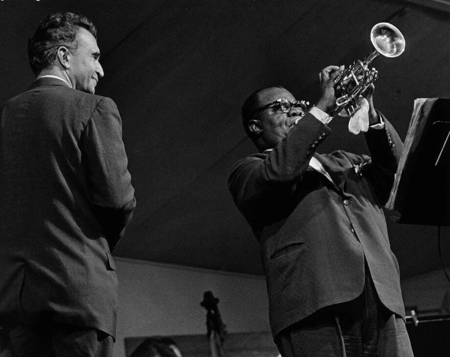 "Dave Brubeck, left, and Louis Armstrong perform at the Monterey Jazz Festival in 1962, as pictured in the book ""Monterey Jazz Festival: 40 Legendary Years. Both Brubeck and Armstrong are subjects of this year's Scholarly Series presented by Wilton Library and the Wilton Historical Society. Photo: Monterey County Herald / AP / Monterey Jazz Festival"