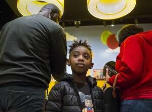 Flanked by her father, Gilbert Glaster, left, and her mother, Crystal Glaster, right, 7-yr-old Genesis Glaster waits while her parents make a purchase at the LEGO store at Rivercenter Mall during a family stroll downtown in San Antonio on Saturday, Nov. 2, 2019. Crystal, who is a lieutenant colonel in the Air Force, returned home Oct. 13 after being deployed to Pakistan for 6 months.
