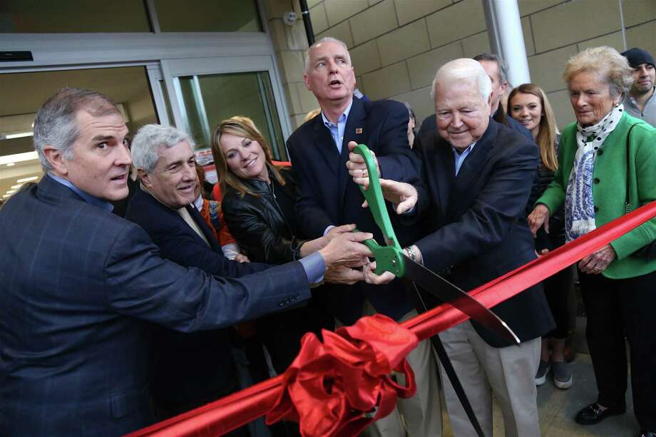 Despite a little rain, the ribbon cutting on Jan. 4 took place outside the new entrance and included, from left, Sean Carroll, fundraising campaign co-chair, Howard Steinberg, former board chair, Dana Nickel, whose family name graces the Welcome Center, CEO Robert McDowell, and George and Carol Bauer, members of the Norwalk Hospital Board of Trustees. Photo: Jarret Liotta / Hearst Connecticut Media / ©Jarret Liotta