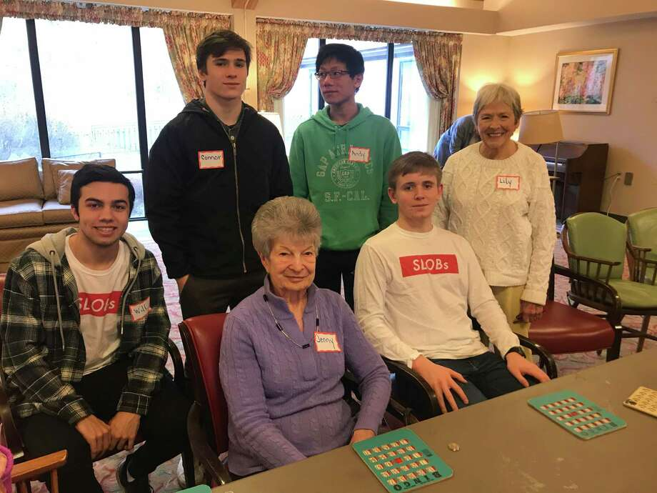 On Sunday, January 5, 2020, New Canaan High School SLOBs, (Service League of Boys), members, Will Galvan, Connor Mastey, Andy Liang and Aidan Smith played bingo with The Inn at Waveny residents Jenny Tiso, and Lily Mayer. Members of the SLOBs have been playing bingo with the residents monthly, for several years. Photo: Contributed Photo