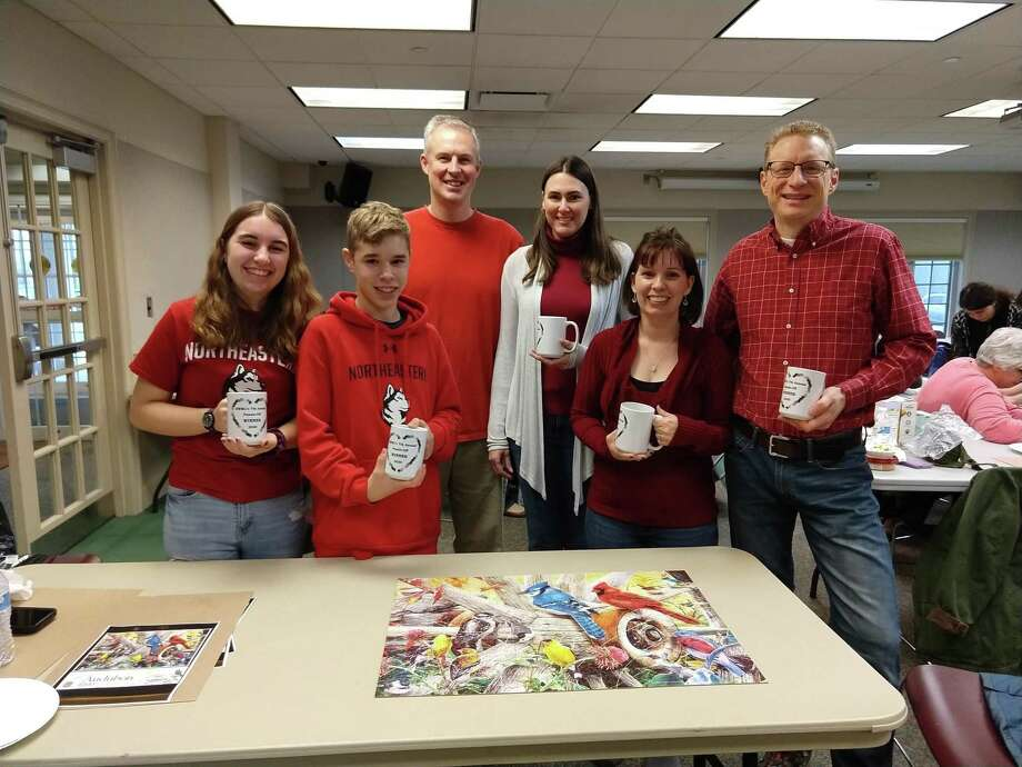 The winners of the seventh-annual Puzzle Off at the Edith Wheeler Memorial Library in Monroe, which took place Jan. 4, 2020: (from left) Hailey Pankow, Jeremy Pankow, Eli Crossman, Deborah Crossman, Juli Pankow, and Dale Pankow. Photo: Edith Wheeler Memorial Library / Contributed