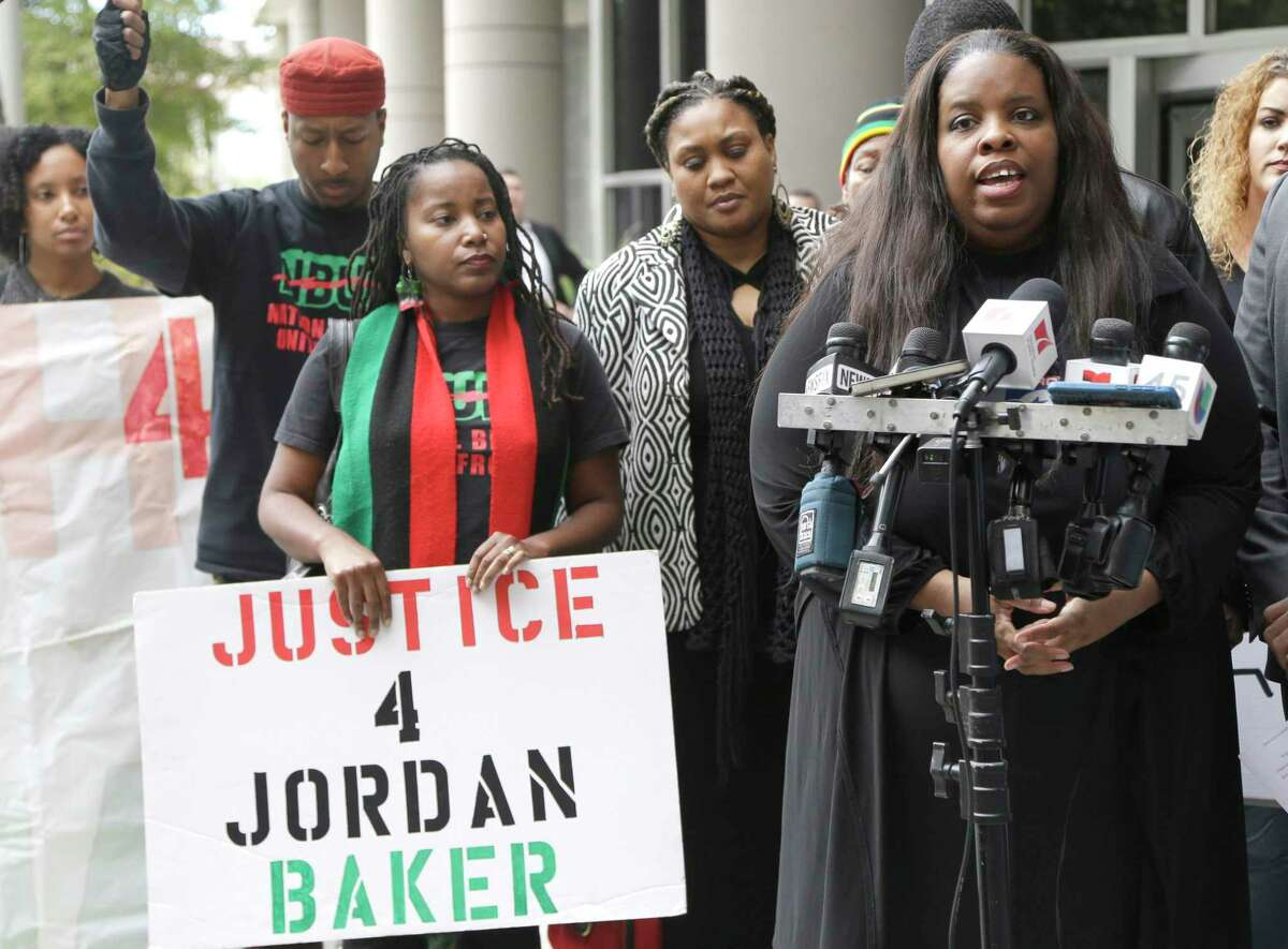 Janet Baker, right, speaks to reporters during a press conference outside the federal courthouse Wednesday, Dec. 2, 2015, in Houston. City Council on Wednesday is set to consider a $1.2 million settlement of Baker's wrongful death lawsuit against the city. (AP Photo/Pat Sullivan)