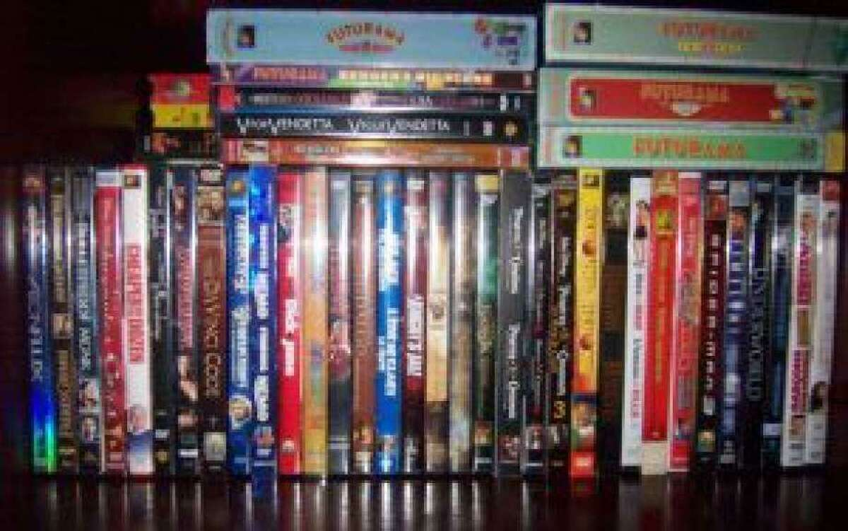 Police say a Shelton woman rented 31 DVDs, then sold them to FYE at the mall.