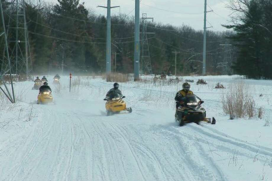 In addition to registering a snowmobile with the Secretary of State, any resident or nonresident who operates a snowmobile in Michigan is required to purchase a snowmobile trail permit. (News Advocate file photo)