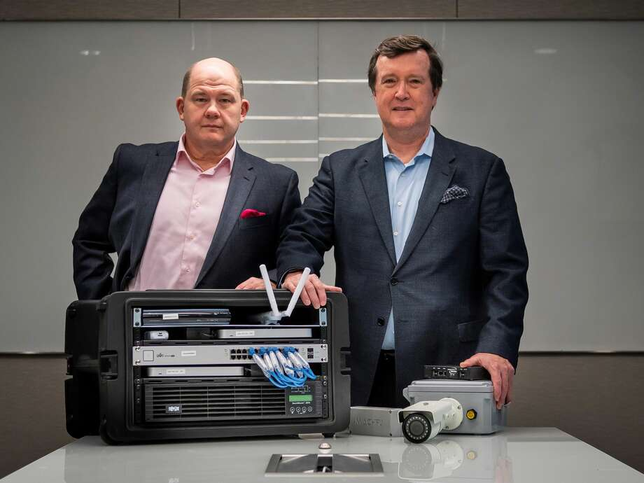 CTO Stanley Hughey, left, and CEO Mark Slaughter with some of the company's technology in the offices of Infrastructure Networks in the Galleria in Houston, Wednesday, Dec. 18, 2019. The Houston-based company recently completed an expansion project with Finnish cell phone equipment maker Nokia. Photo: Mark Mulligan | Houston Chronicle
