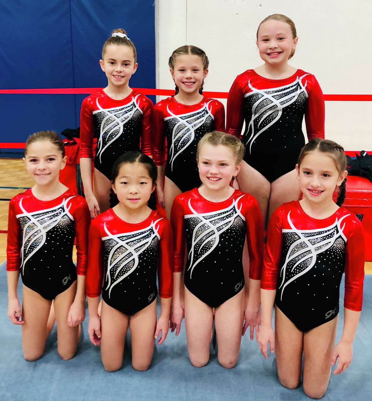Wilton YMCA gymnasts Piper Young, Nora Walencikowski and Kensey Diglio (back row, left to right) and Allison Massaua, Brianna Shiue, Jane Carroll, and Lily Blessing (front row, left to right) competed for the first time at the Snowflake Invitational.