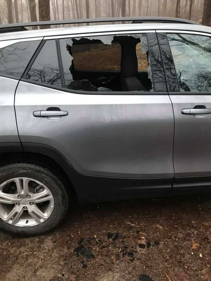 The vehicle window smashed in at the upper Paugussett State Forest parking area off Echo Valley Road on Saturday. Photo: Facebook