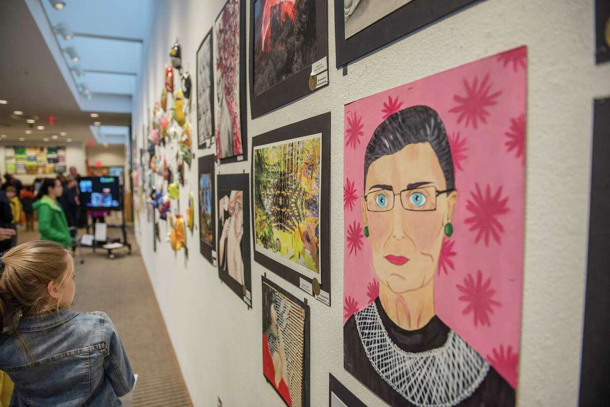Works of art line the walls of Wilton Library at the opening reception of the Wilton School District's Fine and Performing Arts Exhibition on April 5, 2019.