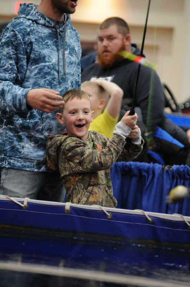 Aron Drake, 7, of Decatur, catches a fish this weekend at the indoor pond during the Let's Go Fishing Show. The 27th annual expo took place at the Gateway Convention Center in Collinsville. Photo: David Blanchette|For The Intelligencer