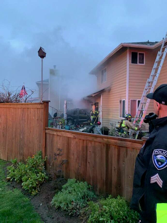 One person died and one person was hospitalized after a car crashed into a power pole and house in Mountlake Terrace on Monday morning. The crash also ignited a fire in the house. Photo: Courtesy South Snohomish County Fire
