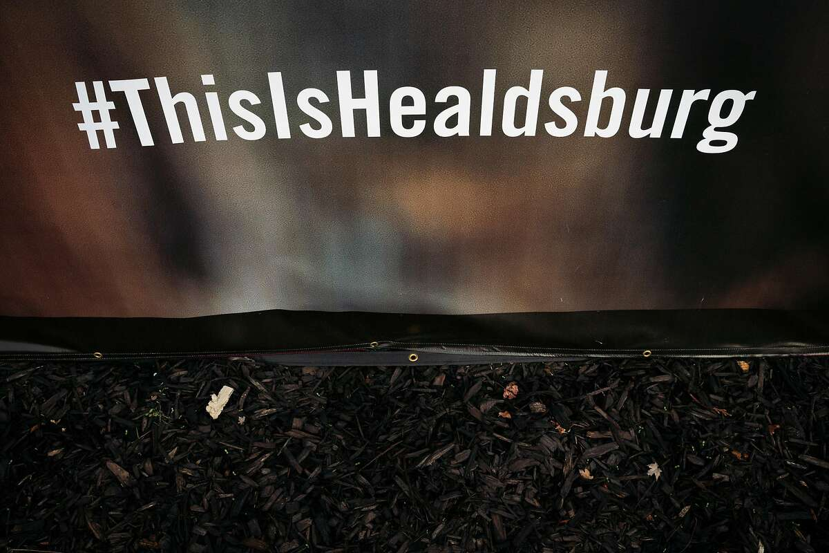 A Healdsburg hashtag is displayed on a fence at the Mill District housing project to bring attention to the wildfires in Healdsburg, Calif., on Thursday, December 12, 2019.