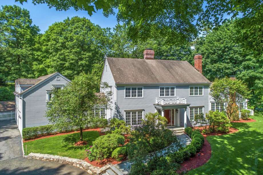 The stately gray colonial at 6 Sipperley's Hill Road was built on a two-acre largely level property.