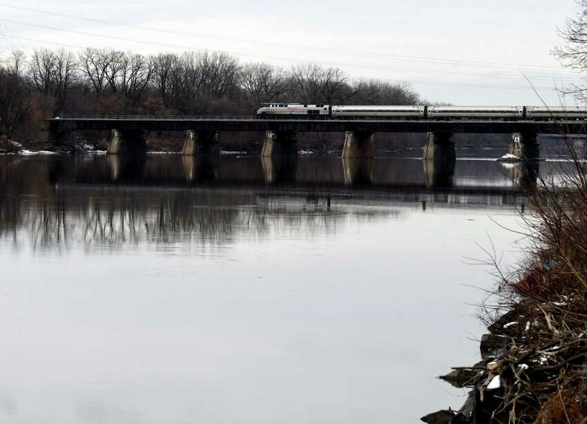 An Amtrak train crosses the Mohawk River at the Stockade on Monday, Jan. 6, 2020, in Schenectady, N.Y. The state on Monday proposed a massive overhaul of the Erie Canal that would see ice breakers put to use to break up the ice that frequently clogs the river. (Will Waldron/Times Union)