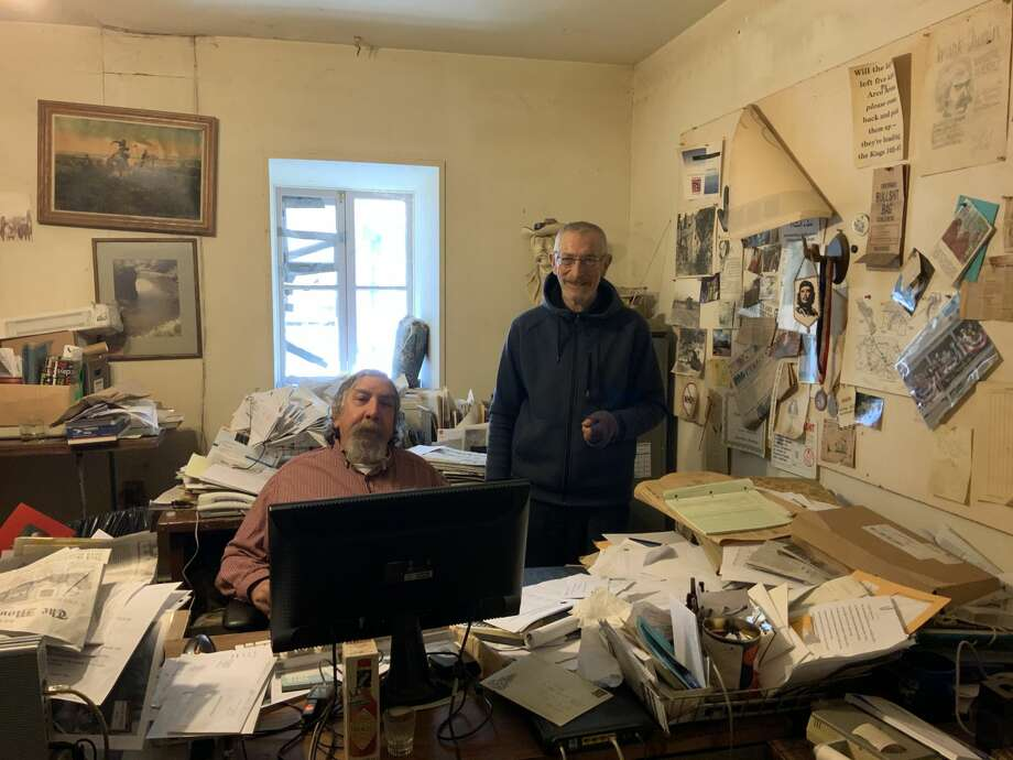 Don Russell (left) is stepping down as publisher and editor of the Mountain Messenger. Carl Butz (right) is taking over on Jan. 20, 2019. Established in 1853, the paper covering Sierra and Plumas counties is the oldest weekly newspaper in California. Photo: Courtesy Mountain Messenger